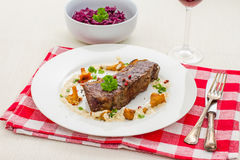 Grilled rump steak with chanterelle mushrooms Royalty Free Stock Photography