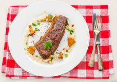 Grilled rump steak with chanterelle mushrooms Royalty Free Stock Image