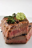 Grilled rump steak with rosemary on a plate Stock Image