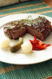 Grilled rump steak with vegetable on a plate Royalty Free Stock Photo