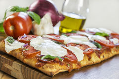 Grilled rustic crust pizza Royalty Free Stock Photos