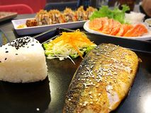Grilled Saba with Rice. Enjoying Japanese meal Stock Photo