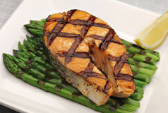 Grilled salmon. Steak with asparagus stock photography