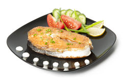 Grilled salmon. A delicious salmon steak with vegetables Stock Photography