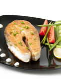 Grilled salmon. A delicious salmon steak with vegetables Stock Photo