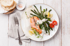Grilled salmon. With asparagus on white wooden background stock images