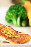 Grilled salmon. Fine garnished  salmon plate with steamed vegetables Royalty Free Stock Images