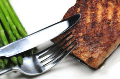 Grilled salmon. A piece of grilled salmon and some green asparagus Stock Images