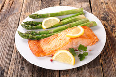 Grilled salmon with asparagus. And lemon Stock Image