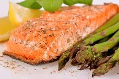 Grilled salmon with asparagus Stock Photos