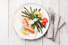 Grilled salmon with asparagus Stock Photos