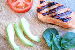 Grilled salmon avocado slices and tomato Royalty Free Stock Image