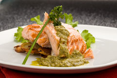 Grilled Salmon with Basil sauce royalty free stock photography