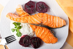 Grilled salmon and beets with rosemary Stock Photo