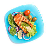 Grilled salmon on blue plate isolated Stock Photo