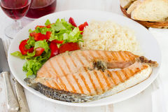 Grilled salmon with boiled rice Stock Image