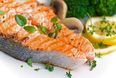 Grilled salmon with broccoli rice and tomato- clos Stock Photography