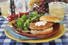 Grilled salmon burger Stock Photography
