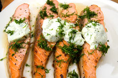 Grilled salmon with cheese and herbs Stock Photo