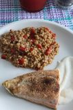 Grilled salmon and chili pearl barley. A plate of grilled salmon and chili pearl barley with yogourt sauce royalty free stock photo