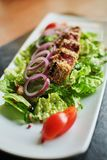 grilled salmon coated in sesame salad with bulgur and vegetables royalty free stock photos