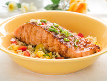 Grilled salmon with couscous royalty free stock photography