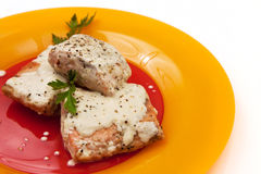 Grilled salmon with cream sauce and parsley Royalty Free Stock Images