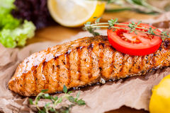 Grilled salmon. Crispy grilled salmon fillet with tomato and herbs Stock Images