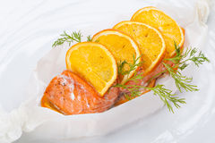 Grilled Salmon decorated with slices of orange Stock Photo