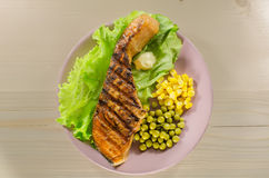 Grilled salmon at dish Stock Photos