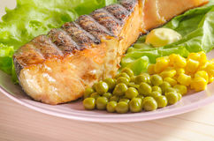 Grilled salmon at dish Royalty Free Stock Photo