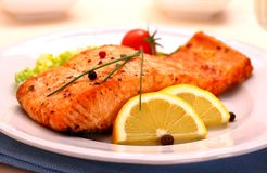 Grilled salmon filet and vegetables Royalty Free Stock Image