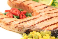 Grilled salmon filler with vegetables. Royalty Free Stock Photos