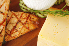 Grilled salmon fillet and cheeses Royalty Free Stock Photo