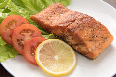 Grilled salmon fillet cooked BBQ and served with fresh herbs and Stock Images