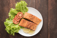 Grilled salmon fillet cooked BBQ and served with fresh herbs and royalty free stock images