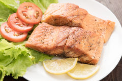 Grilled salmon fillet cooked BBQ and served with fresh herbs and Stock Photography
