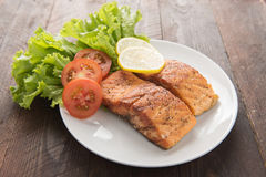 Grilled salmon fillet cooked BBQ and served with fresh herbs and Stock Photo
