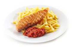 Grilled salmon fillet and french fries stock photo