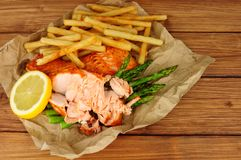 Grilled Salmon Fillet And Fries Meal Royalty Free Stock Images