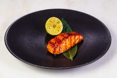 Grilled salmon fillet. With lemon royalty free stock images