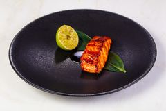 Grilled salmon fillet. With lemon royalty free stock photography