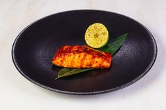 Grilled salmon fillet. With lemon stock photos