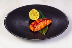 Grilled salmon fillet. With lemon stock photography