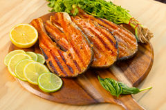 Grilled salmon fillet with lime and parsley on a stock image