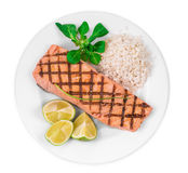 Grilled salmon fillet with risotto. Isolated on a white background Stock Photos