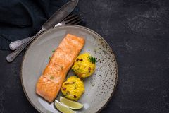 Grilled Salmon Fillet with Saffron Risotto. On Dark Background stock image