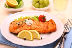 Grilled salmon fillet, sauce and vegetables Stock Image