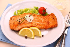 Grilled salmon fillet, sauce and vegetables Royalty Free Stock Photos