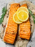 Grilled salmon fillet with slices of fresh lemon stock photos